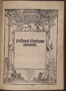 The title page for the book showing the title in a gothic type, surrounded by an ornamental woodcut border of architectural and statuary elements.