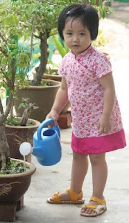 NAMC montessori practical life activities home classroom girl watering plants