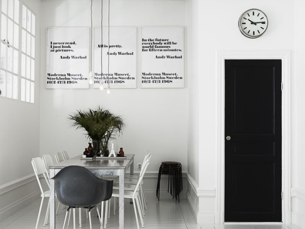 Typography Interior Design Minimalist Dining Room Glass Dining Table with White Chairs Indoor Plants Black Door Wall Clock Graphic Art