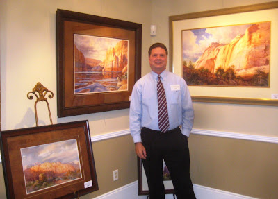 Roland Lee by his paintings at the Canyon Country art exhibit