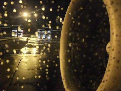 sitting in a plane, in the rain, on the window
