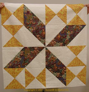 Quilt top with hour glass blocks