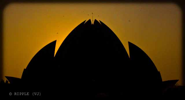 Sunset View @ Lotus Temple, Nehru Place, Delhi: The Baha'i House of Worship in Delhi which is popularly known as the Lotus Temple due to its flower like shape, is a Bahai House of Worship and also a prominent attraction in Delhi. It was completed in 1986 and serves as the Mother Temple of the Indian subcontinent. It has won numerous architectural awards and been featured in hundreds of newspaper and magazine articles.: Posted by Ripple (VJ) on PHOTO JOURNEY @ www.travellingcamera.com : ripple, Vijay Kumar Sharma, ripple4photography, Frozen Moments, photographs, Photography, ripple (VJ), VJ, Ripple (VJ) Photography, Capture Present for Future, Freeze Present for Future, ripple (VJ) Photographs , VJ Photographs, Ripple (VJ) Photography : Color changes to dull yellowish as time passes... This is again a silhouette of Lotus Temple with coring color of Sunset...
