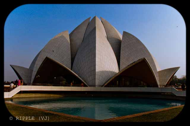 A good place to visit in Delhi : Lotus Temple @ Nehru Place, Delhi, INDIA: Here are some some miscellaneous shots of Lotus Temple. The construction of the temple is similar to that of the Opera House in Sydney. The temple always looks mesmerizing. However, different light conditions have different effect on the way the temple appears.: Posted by Ripple (VJ) on PHOTO JOURNEY @ www.travellingcamera.com : ripple, Vijay Kumar Sharma, ripple4photography, Frozen Moments, photographs, Photography, ripple (VJ), VJ, Ripple (VJ) Photography, Capture Present for Future, Freeze Present for Future, ripple (VJ) Photographs , VJ Photographs, Ripple (VJ) Photography : The Lotus Temple during the day time @ Nehru Place, Delhi, INDIA