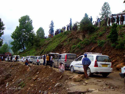 Busy route of Rohtang Pass, which leads to heavy Traffic Jams in Summers: The road through the Kullu Valley, past Manali and over the Rohtang Pass to Keylong, and Lahul and on to Ladakh, has become very busy during the summer months as an alternate a military route following the Kargil Conflict in 1999 in addition to tensions in Kashmir. Traffic jams are common as military vehicles, trucks, and goods carriers try to navigate the tight roads and rough terrain, compounded by, snow and ice at certain points and the large number of tourists vehicles. There are a lot of dhabas or Indian-style food shacks and eateries along the way.:Posted by Ripple (VJ) on PHOTO JOURNEY @ www.travellingcamera.com : ripple, Vijay Kumar Sharma, ripple4photography, Frozen Moments, photographs, Photography, ripple (VJ), VJ, Ripple (VJ) Photography, Capture Present for Future, Freeze Present for Future, ripple (VJ) Photographs , VJ Photographs, Ripple (VJ) Photography : View of new Traffic Jam near Marhi. Most of the tourists are just looking at the Traffic Jam conditions & some of them are frustrated because they have already spent 4 Hrs in this Jam...