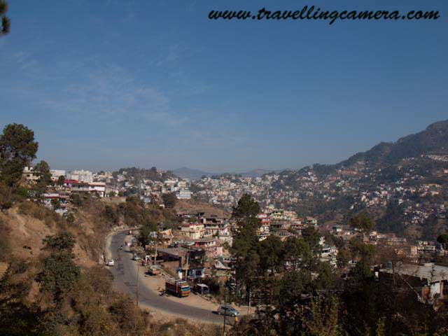Photo Journey to Solan Town from Himalyan Queen - unedited photographs of Mushroom City of India: Posted by VJ SHARMA at www.travellingcamera.com : Solan is one of the district in Himachal Pradesh having most of the industrial and educational institutions in the State. Solan City comes on the way from Kalka to Shimla and all these photographs have been clicked from moving Himalyan Queen on narrow gauge railway track...Since I started journey from Shimla, the first thing we encounter in Solan in Mohan Mekin's Brewwery which is one of the oldest and reputed brewery in India... Its famous  for Old Monk XXX RUM, Solan No.1 whiskey and Golden Eagle beer...This whole campus belong to Mohan Mekin's Brewery and most of the employees have residences inside..Solan is easily accessible by road as well as train... It is 70 km from Chandigarh (2.5 hrs journey by bus) and 50 kms from Shimla (1.5 hours journey by bus). There are a total of 44 railway tunnels up to Solan...Solan is a beautiful place to live... Its a valley having wonderful weather most of the time in an year... There are many toursit places around Solan like Kasuali, Chail and Barog... Solan itself is a beautiful town with wonderful weather... Its very crowded now and its span is increasing day by day....Chambghat is another main town around Solan, having multiple private companies and some research centers...Solan is known Industrial town... Apart from the well known Baddi, Nalagarh, Barotiwala Industrial areas which belong to Solan District and the well known Mohan Meakin Breweries, Solan town itself is home to many important industries namely, Base terminal Batteries, HFCL (Exicom), Shivalik Bimetal Controls Ltd., Himalyan Pipe Industries and many more. Solan is home to a large number of Pharmaceutical units too...All these photogrpahs have been shot from Himlyan Queen which runs between Shimla and Kalka...