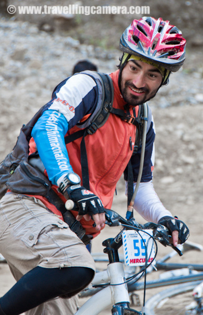 Riders getting ready for 7th Day of MTB Himachal 2010 @ Shavad - 29th Oct 2010-01 : Posted by VJ SHARMA on www.travellingcamera.com : It was almost the ending of MTB and we had to move from our second last camping site at Shavad village... It was a high school ground where we had installed our tents... Now it was time to move on and pack all our stuff for next journey... Some of the school children were coming early to school to watch the flag of the day by Principal of Government High School Shavad... Here are few photographs of that morning when various riders are indulged in lot of different activities... Check out !!! : Here is Mr Aneesh, one of the champions of MTB group !!! He was in 'more' action on second last day of MTB Himachal 2010 and showed us lot of stunts on cycle and motor-bike... He was simply awesome... I don't know if someone has video of these stunts or not... If I don't find in net few weeks, I can create one out of the photographs I have... I was not ready for this moment and missed some part of all this.. We were busy in having breakfast on other part of the ground...Here is a photograph showing our camp at Shavadh government school ground. You see some of the tented have been packed on the left bottom of this photograph.... So all the riders are out of their tents and breakfast is being served near pink tent on the right top... Riders discussing the strategy for the day :) I am not sure what's the topics of their discussion but I enjoyed lot of discussions with this group .. . Mr. Sameer explaining something to other riders of MTB Himachal 2010 ..A Maharashtra Policeman @ MTB Himachal 2010 .... He has participated in various contents within India and outside in bike riding... A photography enthusiast and planning to an exhibition with some of his friends in West Bengal and Maharshtra...Dutta Ji, another rider from Maharshtra who doesn't wear shoes by choice... A very gentle guy and I never saw fatigue on his face even after toughest stretches of MTB 2010...Few more stunts with motorbike... Mr. Aneesh also showed few stunts with his bike and he was not able to showcase all due to less space in that ground... Everyone was very excited to see all this and no one wanted it to stop... But suddenly a call for flag-off broke the pleasant environment of high energy stunts... Mr. Ajay who has been asking me about his photographs and I am feeling very sorry that first photograph of Ajay is with closed eyes :) But he is still looking handsome here... So let me introduce Ajay... He is video enthusiast, an extremely talented creative director and has worked on various projects in short span of his career... You can check out his work @ http://www.ajaysaklani.com/ . On Facebook, he can b reached at http://www.facebook.com/as.silentjourno .. We all are waiting for his final video on MTB Himachal 2010...During these 8 days of MTB Himachal I have seen passion of each and every rider ... Although had some bad experiences during this and bad should not be highlighted unless the responsible people say no for improving further :) One of the rider from Kullu and MTB Himachal 2010 was his first experiment with bike riding on real himalayan terrains... But he was disappointed by the fact that they are not following the initially planned terrain.. Actually when he registered for MTB Himachal, he was told about a different route and that was not the reality in the end... But all this happens when weather is not with you during the final event... I had a quick chance to meet him on Mall Road after completion of the event at Ritz and he expressed his opinion which should not be disclosed here :)Another rider @ Shavad during MTB Himachal 2010... I think he is also from Kullu district of Himachal Pradesh.. So there lot many local riders from Himachal only...Jogi Bhai, an interesting fellow from Manali and always smiling... We had lot many chats with him and enjoyed all of them.. a fan of his own bike and take care of her like anything :) He was also excited to see bikes with Army riders and dreaming of one like that... Hope to see you soon, Jogi !!!Again Aneesh playing with his cycle... He gets bored if he drive the vehicles in normal way.. be it a motorbike, cycle or car... Jimsee in Acton !!! Here is Jimsee clicking some of the photographs during flag-off from Shavad school... Jimsee belongs to Mangolia and a freelance Photographer.. Her portfolio can be checked at http://www.flickr.com/photos/jimsgene/ Few riders waiting for the beginning of the day !!!