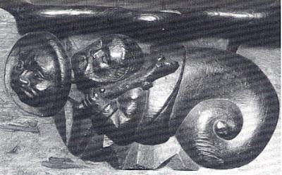 guerreiro selvagem a sair de casca de caracol, catedral de Notre-Dame de Villefranche-de-Rouergue, séc. XV