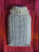 hot-water bottle wearing a little Aran sweater