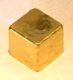 Photo of a cube of gold.