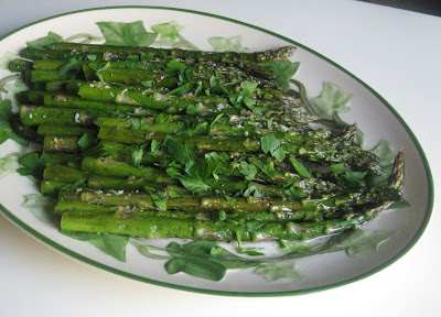 Baked Asparagus, baked with olive oil, minced garlic, and a sprinkle of parmesan cheese. Easy and elegant!