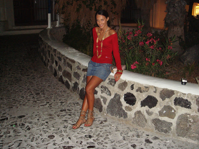 denim mini skirt red cardigan tanned snakeskin gladiator sandals wood jewelry