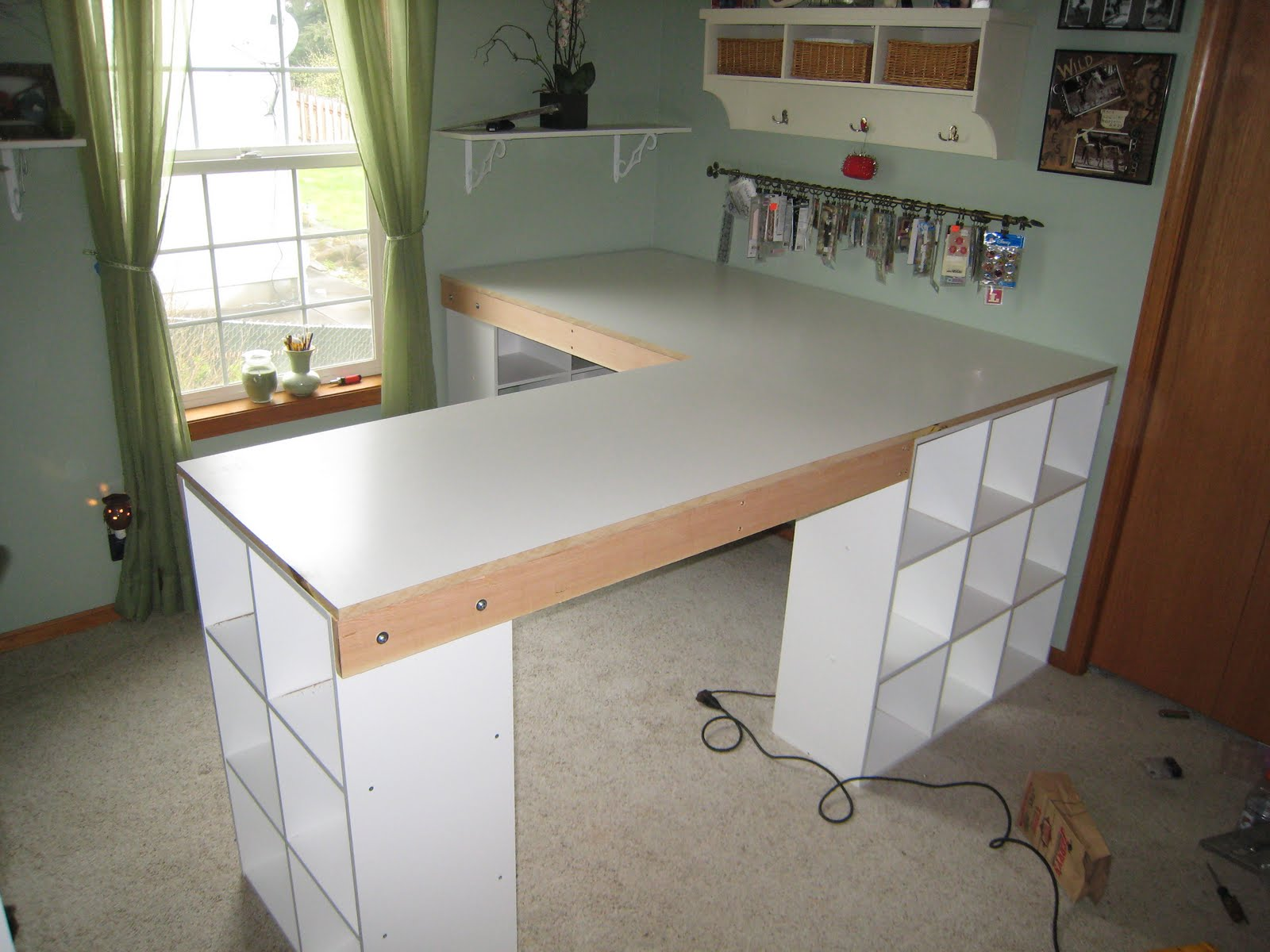 Do it yourself white craft desk how to build a custom for Wrap around desk plans