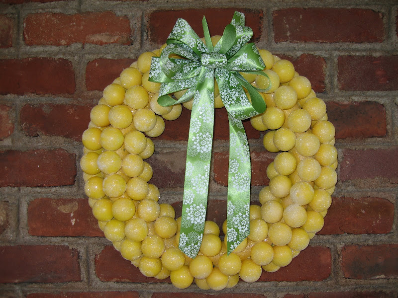DIY Lemon Head Wreath for Spring -  Make a spring wreath that looks like Lemon Head candies!  #spring #springwreath