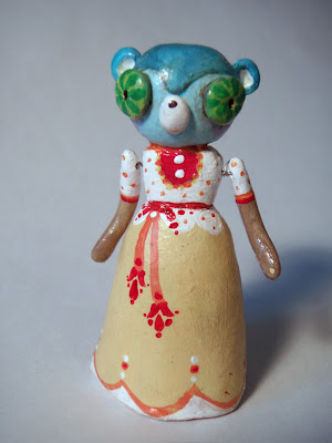 tiny clay figurine