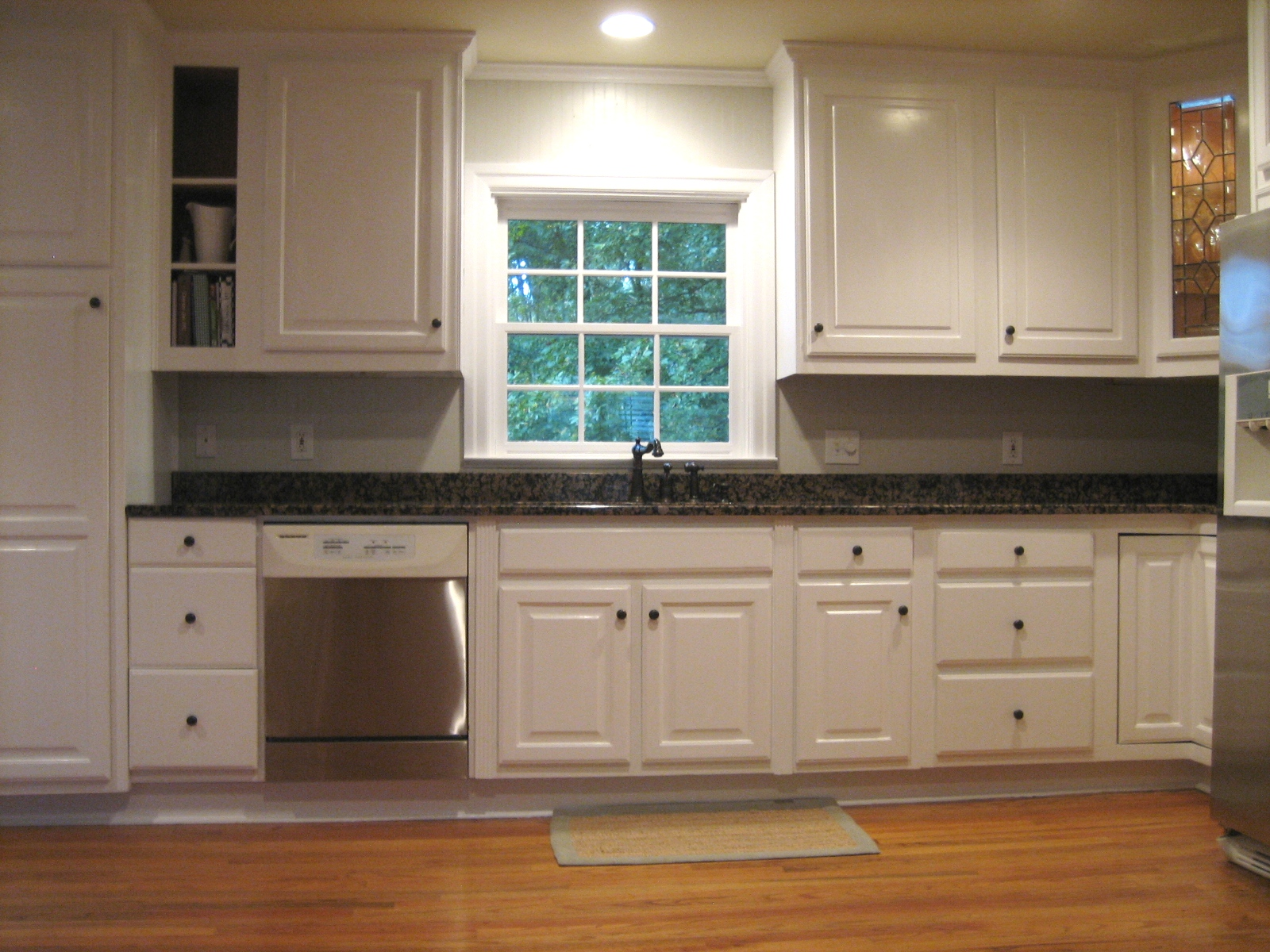 white kitchen wall cabinets farm sink cream color and slate floor grey