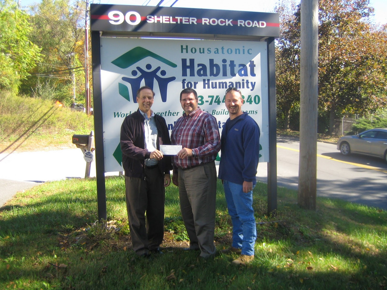 Photo Caption Shemin Ceo Steffan R Burns Delivers Check For Proceeds From A Golf Outing That Raised Over 25 000 Habitat Humanity
