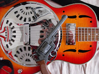 My trusty resonator, in a rejected shot from the album cover shoot