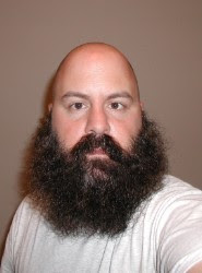 Guys with shaved heads and beards