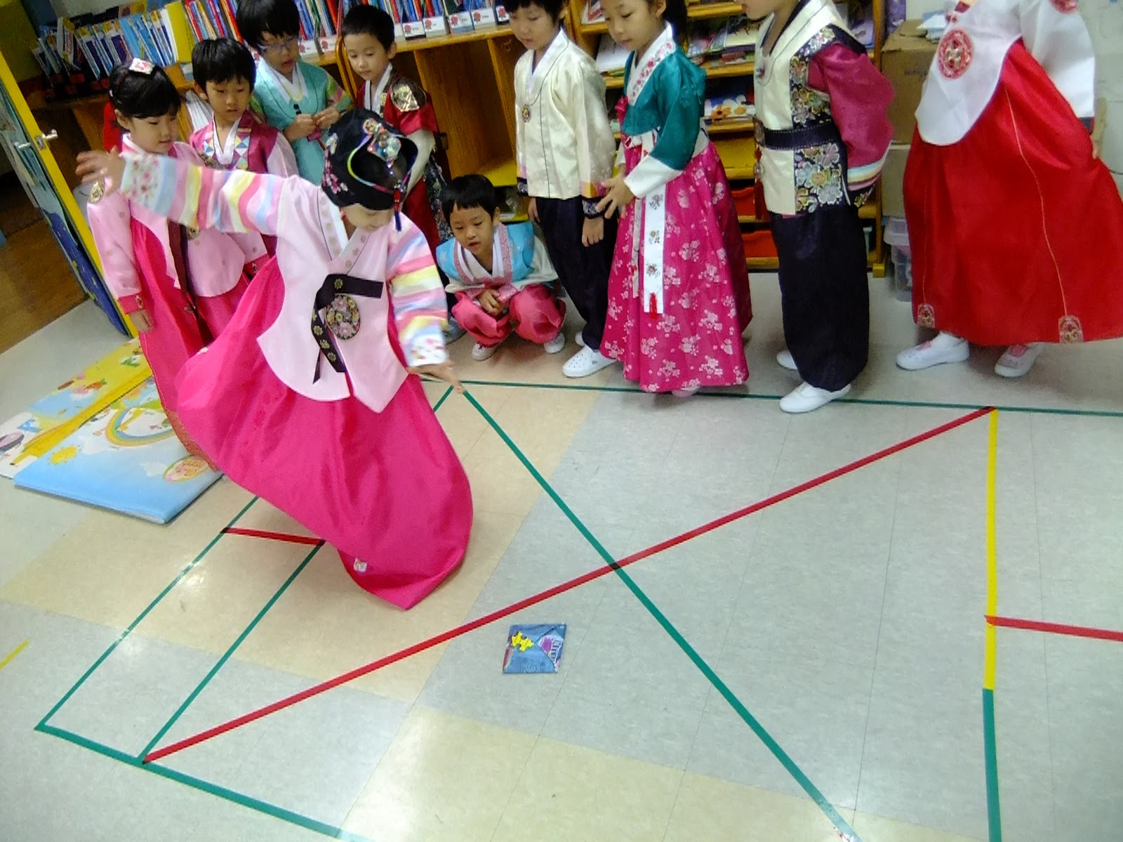 Playing traditional games: Korean hopscotch