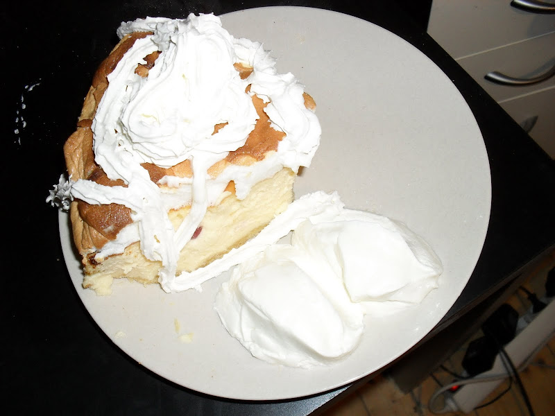 Cheesecake with some whipped cream on a plate
