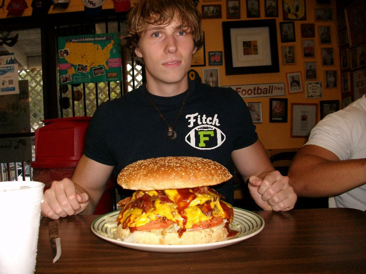 Josh in front of a big Cheeseburger