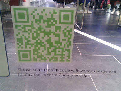 Lacoste store QR codes shop window close up