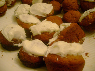 pumpkin cake bites topped with cream cheese frosting