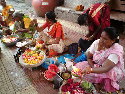 Flower and diya sellers at the Godavari river in Nashik