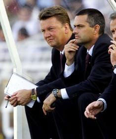 Louis van Gaal and his then assistant Jose Mourinho watch from the bench