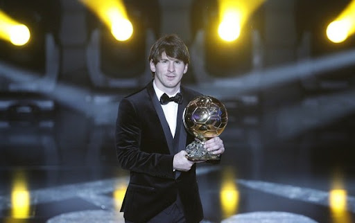 Lionel Messi holds the trophy after he was awarded with the FIFA Ballon d'Or