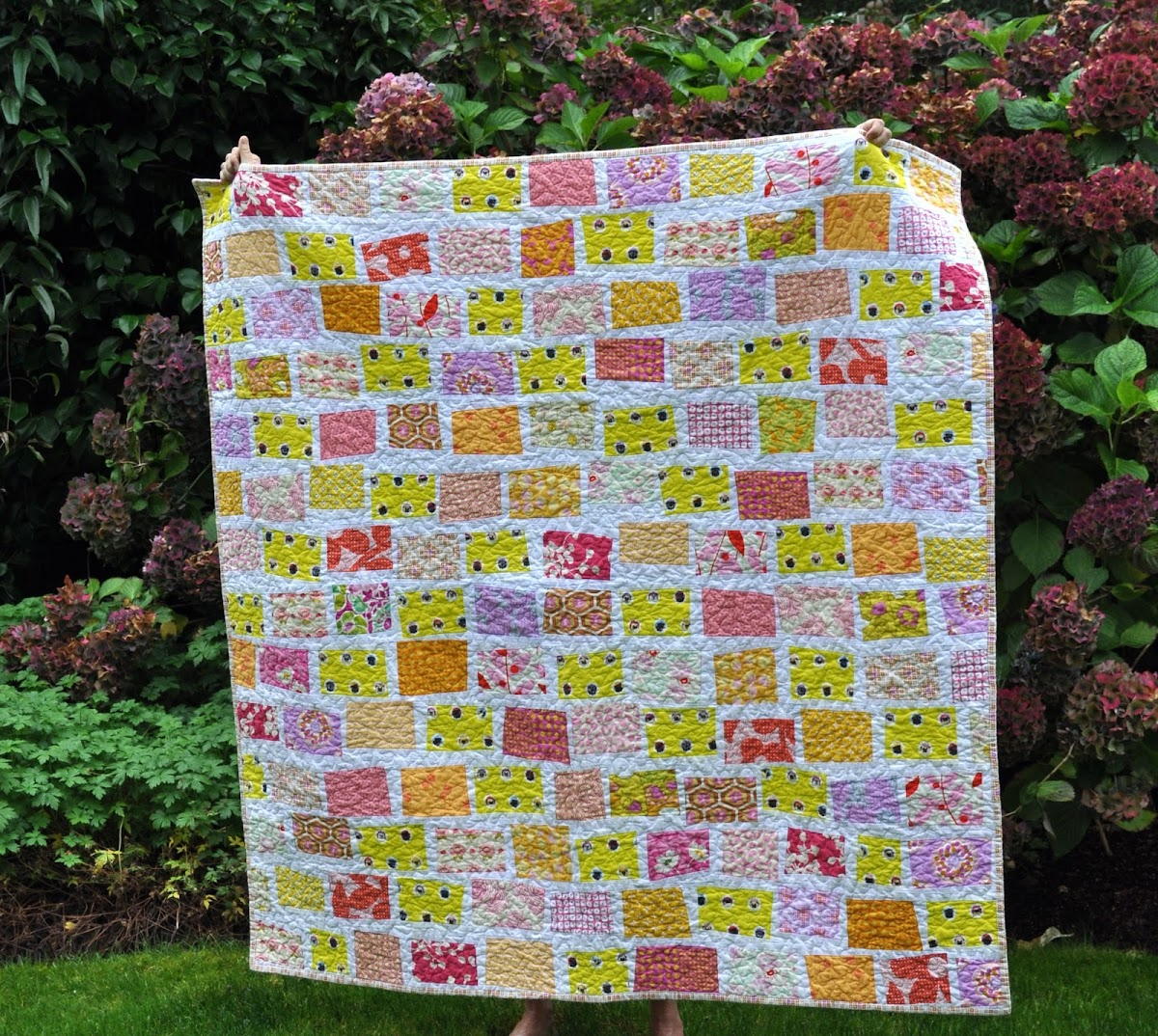 The Wonky Yellow Brick Road Quilt (in pug)