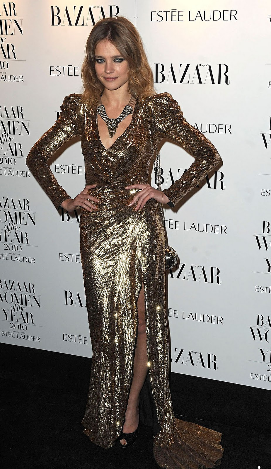 1ac1a75fe8 Russian model Natalia Vodianova attended the Harper s Bazaar Women Of The  Year Awards earlier this month in a gold sequin Balmain dress.