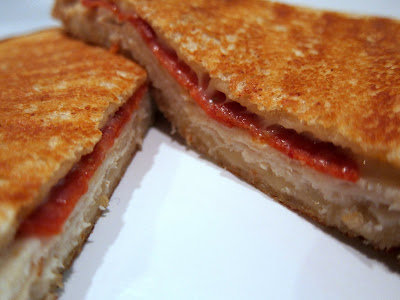 Grilled Chicken and Pepperoni Panini - copycat recipe from Edgar's Bakery. Sourdough bread, butter, garlic, pepperoni, mozzarella, sliced chicken or turkey deli meat. Serve with warm pizza sauce for dipping. SO good!!!