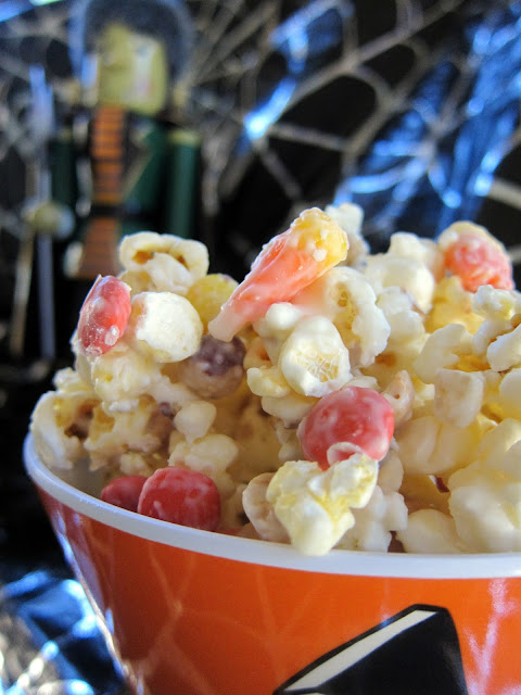 Monster Munch Halloween Mix - popcorn, candy corn, peanuts, Reeses pieces and almond bark - this stuff is crazy good! EVERYONE loves it! It is a great treat for the classroom, neighbors and friends. I have a hard time sharing it! :)