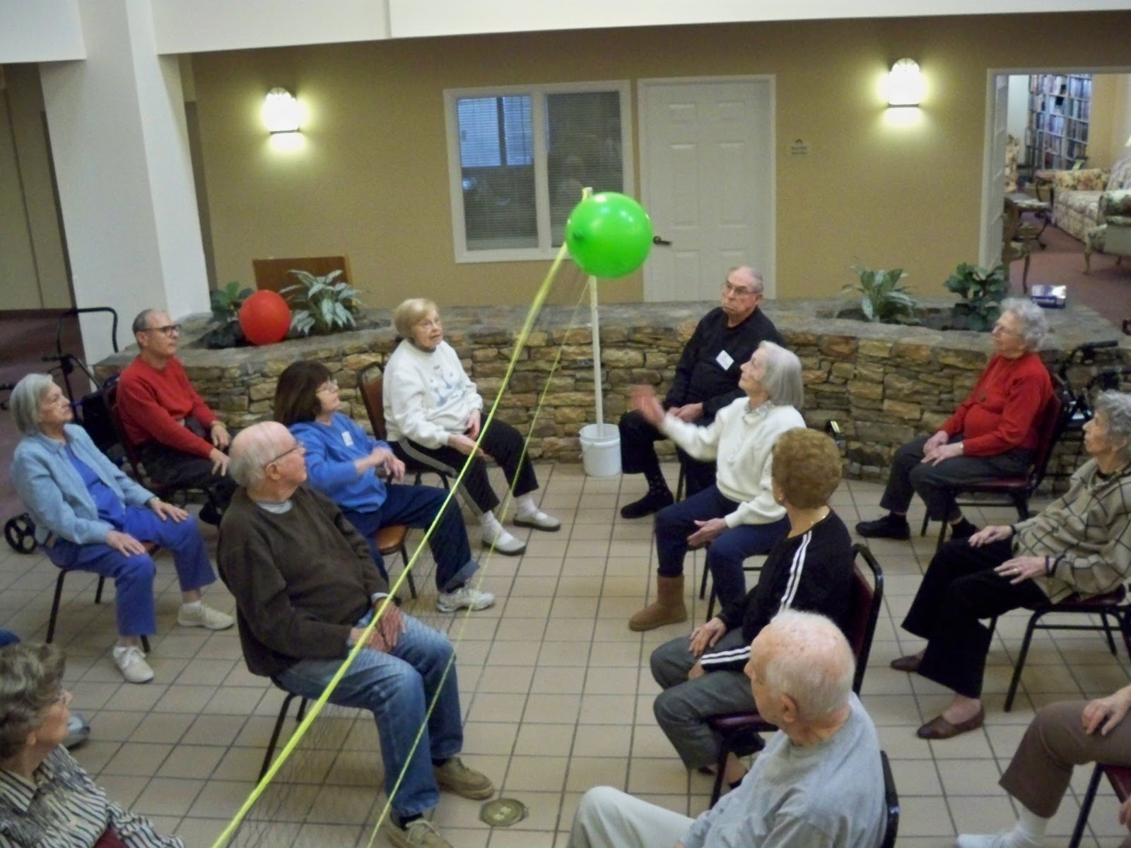 Chair Games For Seniors Yellow Upholstered Rocking Dunwoody Pines Retirement Living Balloon Volleyball At 2
