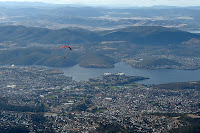 Paraglider sails off into the Hobart sky from near the Mount Wellington summit - 7th August 2010