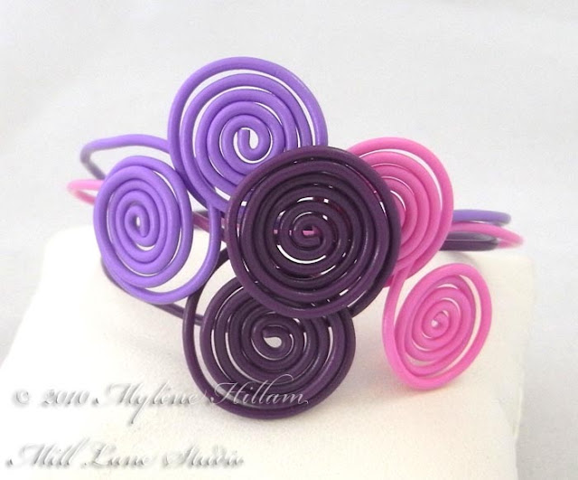 Pink and Purple interlocking spiral bracelet stack.