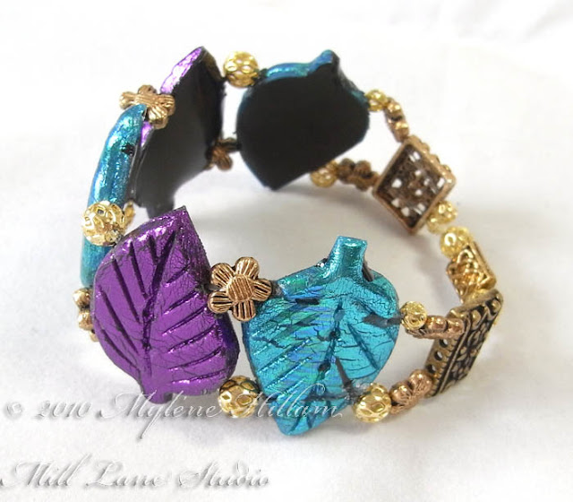 Purple and Turquoise Friendly Plastic leaf bracelet from the side view. It shows the metal spacers around the back of the bracelet.