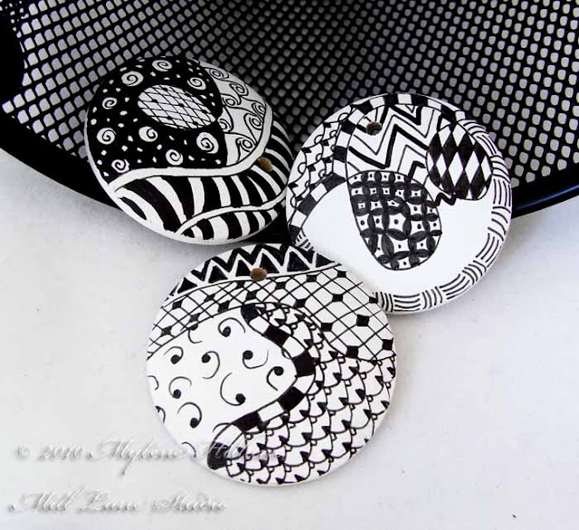 Three black and white Zentangle wooden pendants