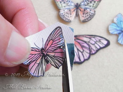 Cutting the butterflies out with fine scissors