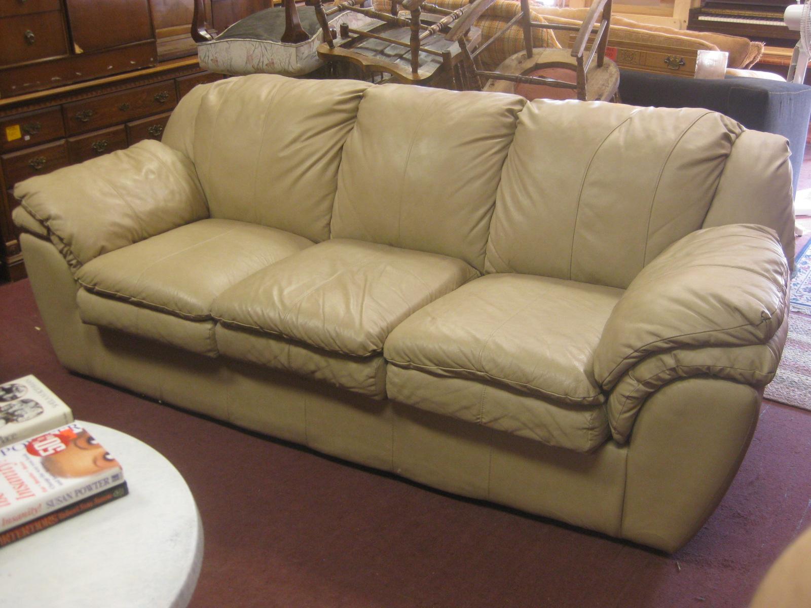 UHURU FURNITURE & COLLECTIBLES SOLD Tan Leather Sofa $250