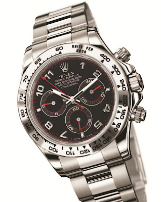 Rolex Oyster Perpetual Cosmograph Daytona, reference 116509 (18K white gold case, bracelet and tachymeter bezel, matt-black dial, Arabic numerals, red chronograph seconds hand, three sub-dials with red hands and accents)