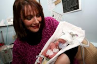 Simone Katz, 43y, with baby Beau last year. He was born three months premature.