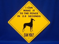 doberman warning sign I can make it to the fence in 2.8 seconds