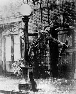 Cantor Cantando-bajo-la-lluvia