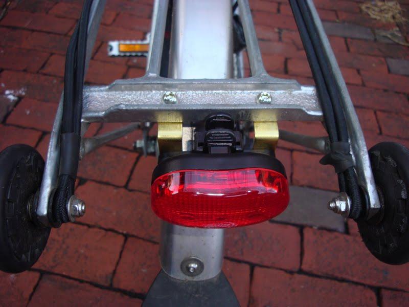 Planet Bike Blinkie Mounted To His Rear Rack Tail Light Brompton