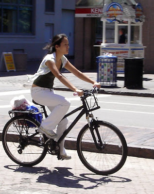 girl on bike in white top