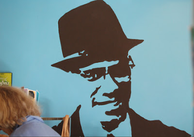 Photo of a stencil of Malcolm X inside Gorilla Cafe