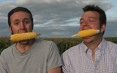 Ian Cheney (left) and Curt Ellis (right) taste their harvest in Greene, Iowa. Photo by Sam Cullman